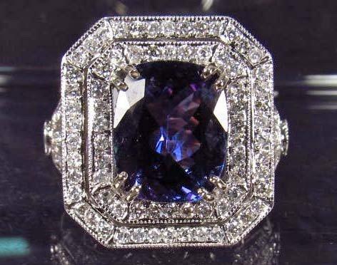 20: 14K WHITE GOLD LADIES TANZANITE AND DIAMOND RING