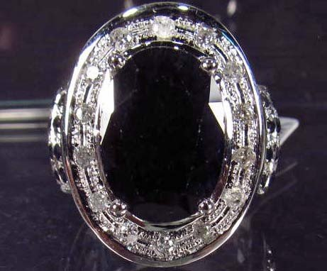 22: PLATINUM PLATE OVER STERLING SILVER SAPPHIRE AND DI