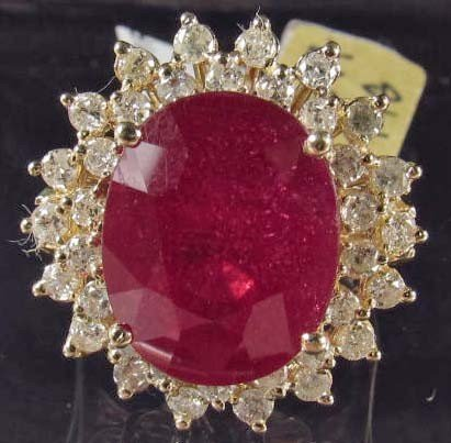 16: 14K GOLD LADIES RUBY AND DIAMOND RING - SIZE 7.25