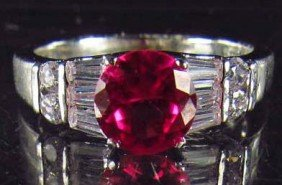 50: 8190 - WHITE GOLD PLATED RUBY & TOPAZ RING - 14.9 C
