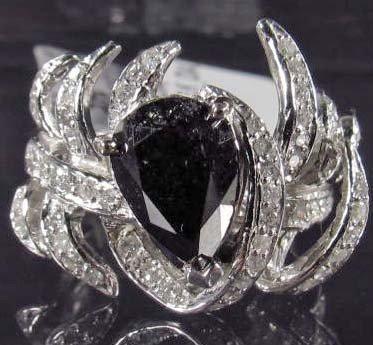 10A: 14K WHITE GOLD LADIES BLACK AND WHITE DIAMOND RING