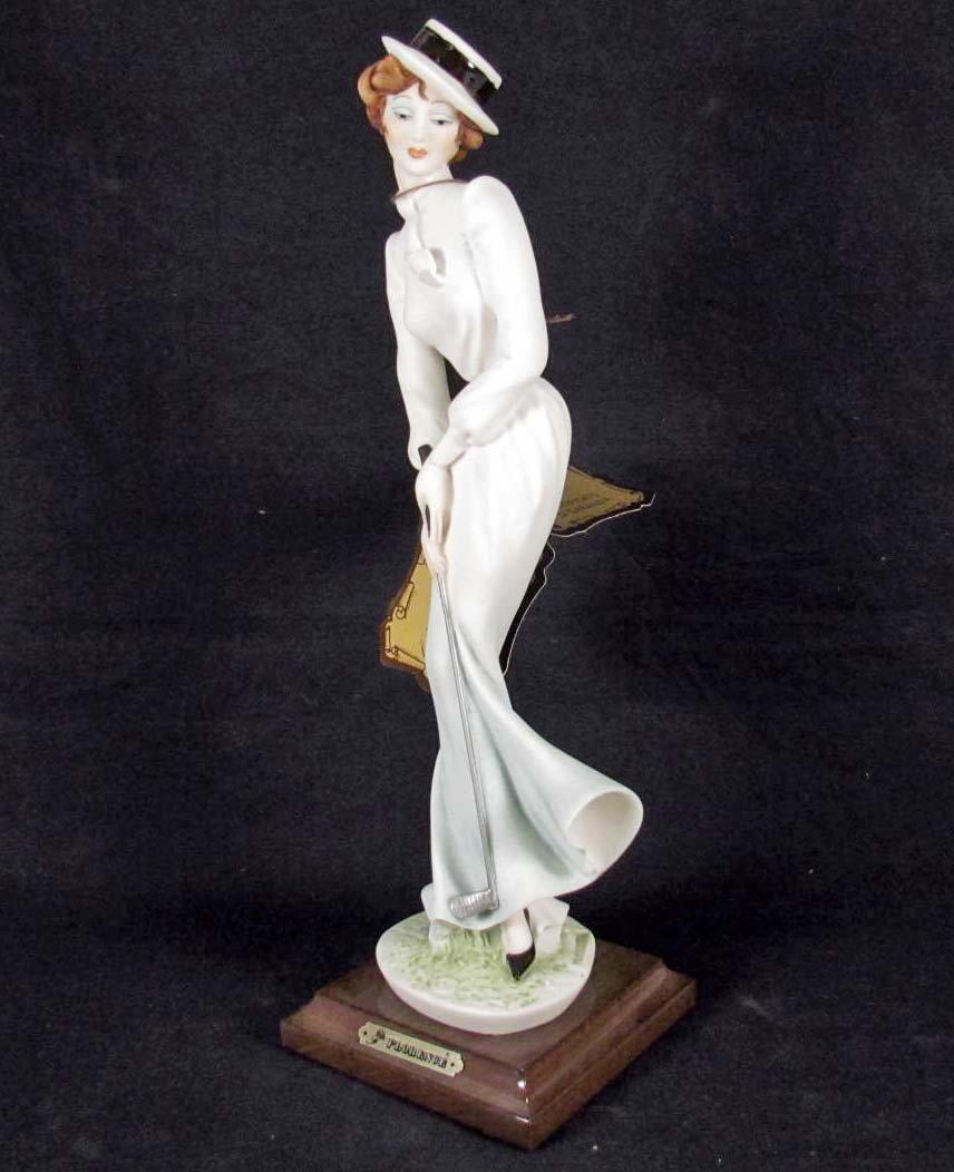 10: G. ARMANI FLORENCE FIGURINE - LADY PLAYING GOLF