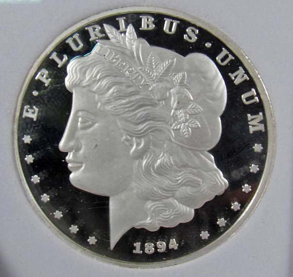 1: ONE OUNCE SILVER ROUND - .999 SILVER