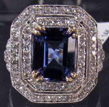 7A: 14K WHITE GOLD LADIES TANZANITE AND DIAMOND RING -