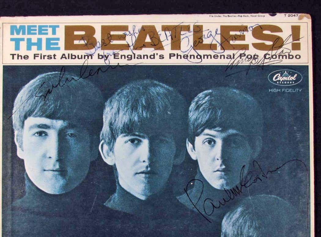 100: VINTAGE BEATLES ALBUM AUTOGRAPHED BY ALL 4