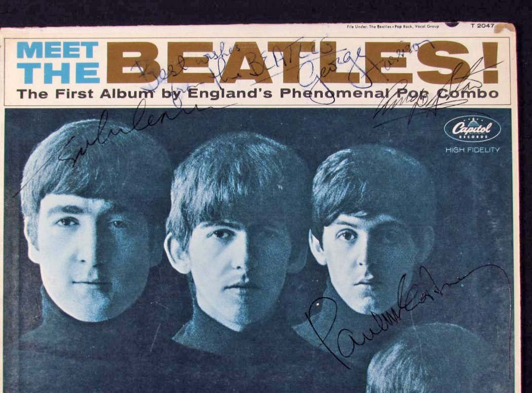 100: VINTAGE BEATLES ALBUM AUTOGRAPHED BY ALL 4