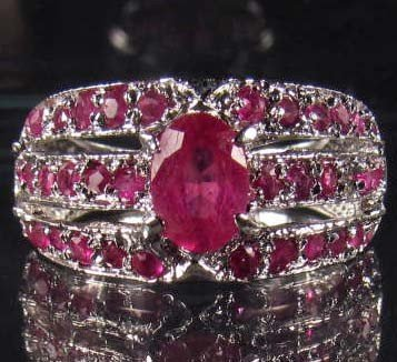 17: STERLING SILVER AND RED MADAGASCAR RUBY RING - SIZE