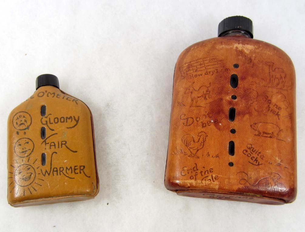 145: LOT OF 2 SMALL LIQUOR FLASKS W/ LEATHER COVERS