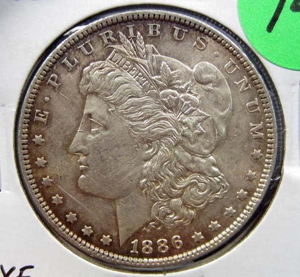 14: 1886-P MORGAN SILVER DOLLAR