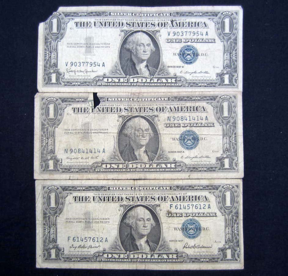 27: LOT OF 3 1957 BLUE SEAL ONE DOLLAR SILVER CERTIFICA