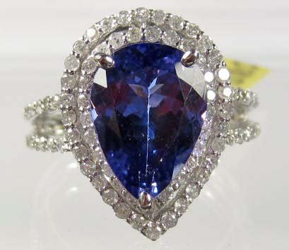 47: 14K WHITE GOLD LADIES TANZANITE AND DIAMOND RING -