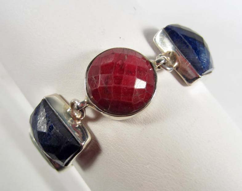 13: STERLING SILVER SAPPHIRE AND RUBY BRACELET