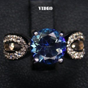 8: WHITE GOLD PLATED BLUE TOPAZ AND STERLING SILVER RIN