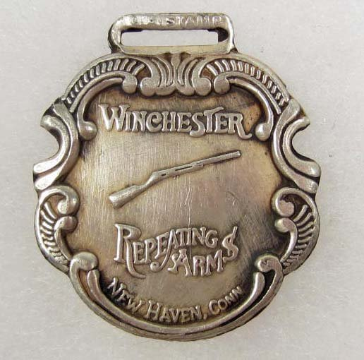16: WINCHESTER REPEATING ARMS ADVERTISING WATCH FOB