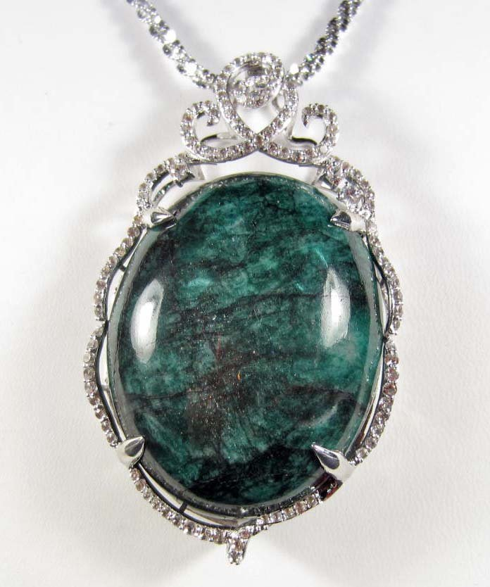 23: PLATINUM OVER STERLING SILVER EMERALD AND SAPPHIRE
