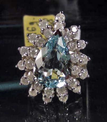 71: 14K WHITE GOLD LADIES AQUAMARINE AND DIAMOND RING -