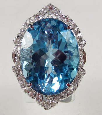 19: STERLING SILVER LADIES BLUE TOPAZ AND SAPPHIRE RING