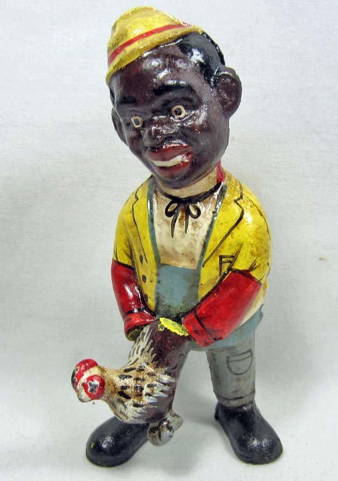 CAST IRON BLACK AMERICANA BANK - MAN HOLDING CHICKEN -