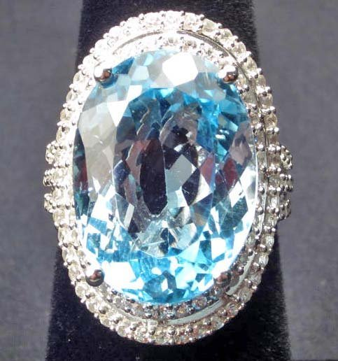 PLATINUM OVER STERLING SILVER LADIES TOPAZ RING - SIZE