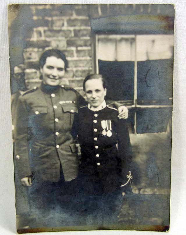 VERY RARE PHOTO POSTCARD OF 2 WOMEN SOLDIERS OR DRESSED