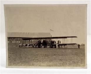 RARE 1927 PHOTOGRAPH OF MEN MOVING A MANTEN BOMBER