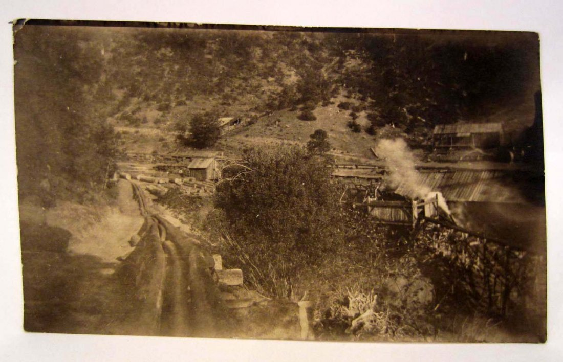 EARLY LOGGING PHOTO OF A LOGGING CAMP IN PORT TOWNSEND