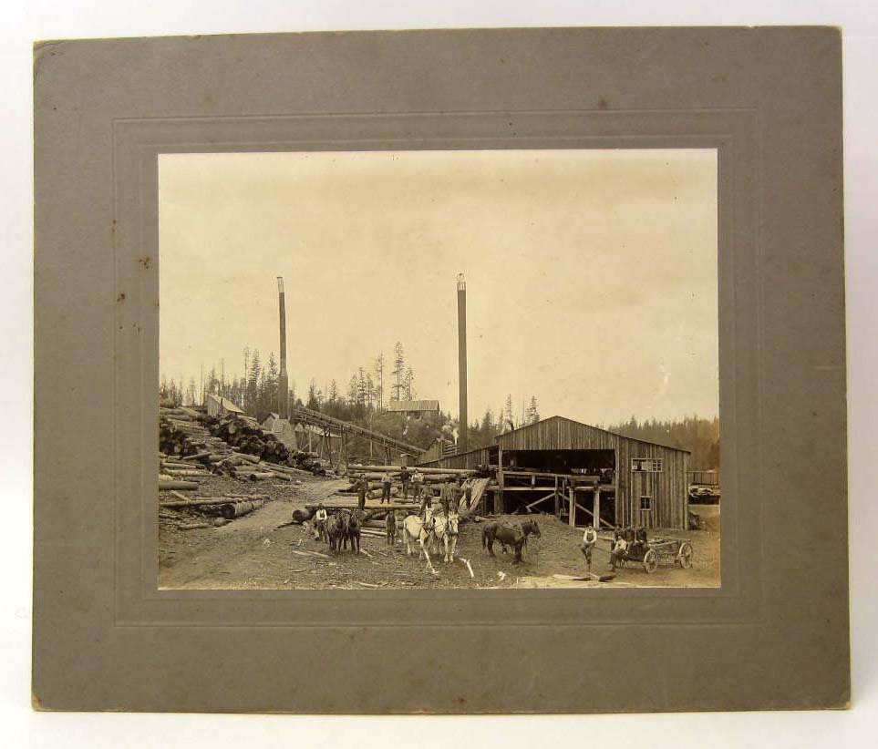ANTIQUE MOUNTED PHOTO OF A LOGGING CAMP