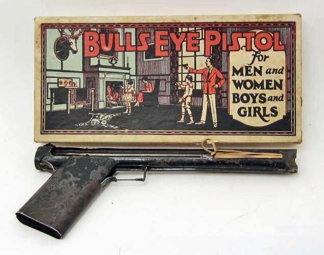 C. 1928 BULLS EYE RUBBER BAND PISTOL TIN TOY W/
