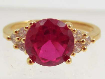 5819 -  GOLD PLATED RED GARNET  & TOPAZ RING SIZE 6