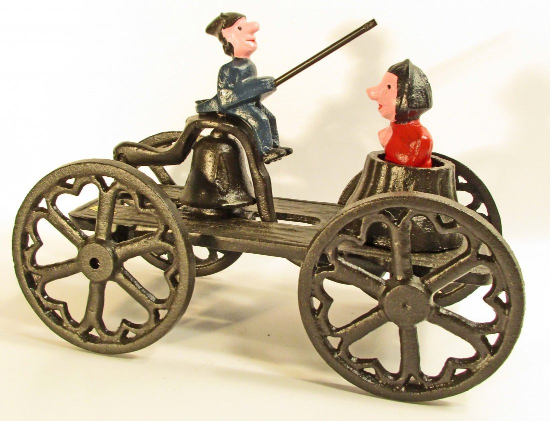 "CAST IRON PUNCH AND JUDY PULL TOY - 9"" LONG"