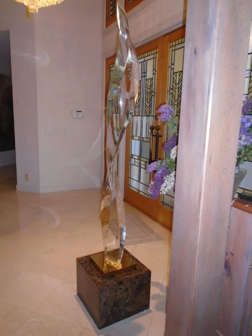 Tall Lucite sculpture on an emperador marble base.