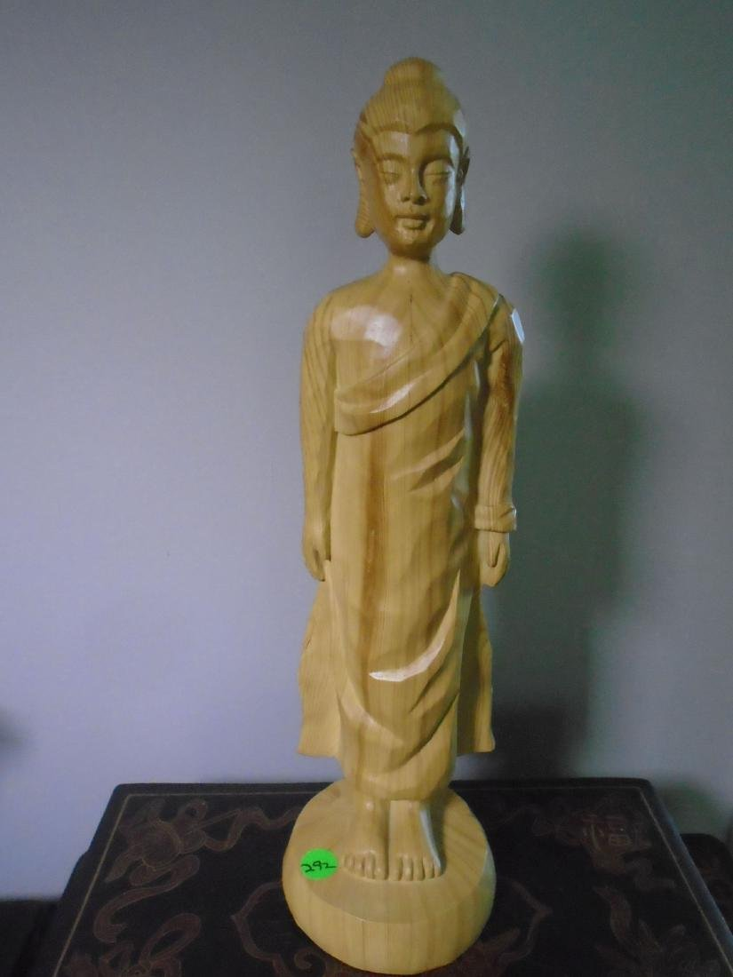 Wood carved standing thai buddha.