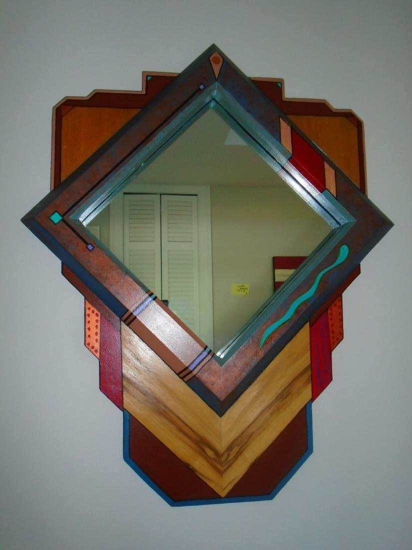 Wall hung mirror with wood frame.