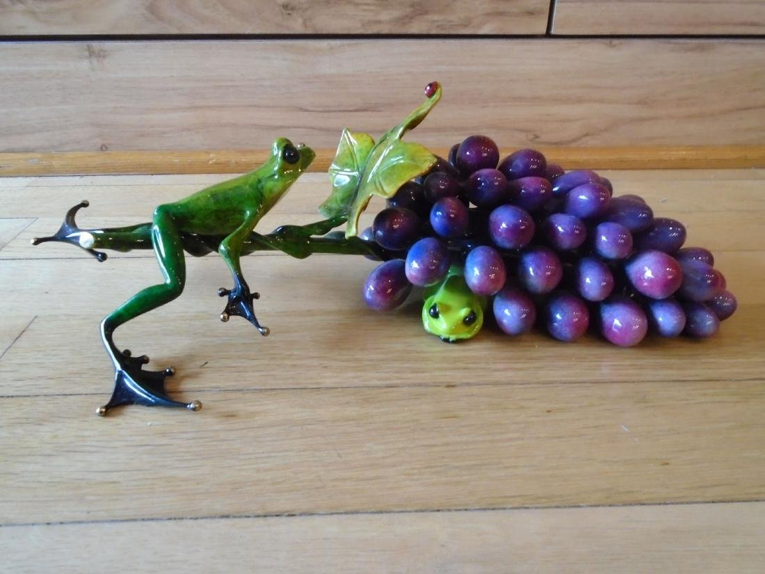 Merlot Green and black frogs with a grape cluster