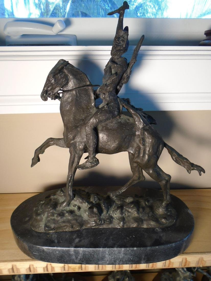 Indian riding a horse Bronze Sculpture