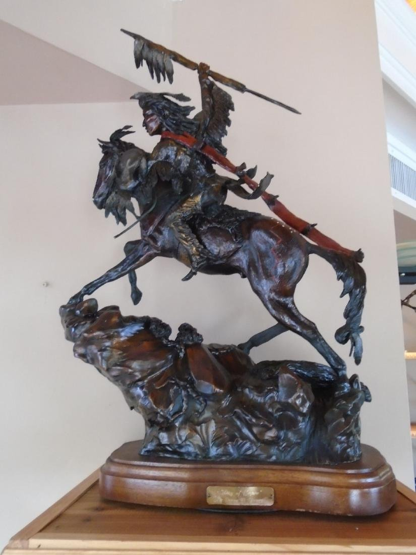 Day of Honor Indian riding a horse holding up a spear