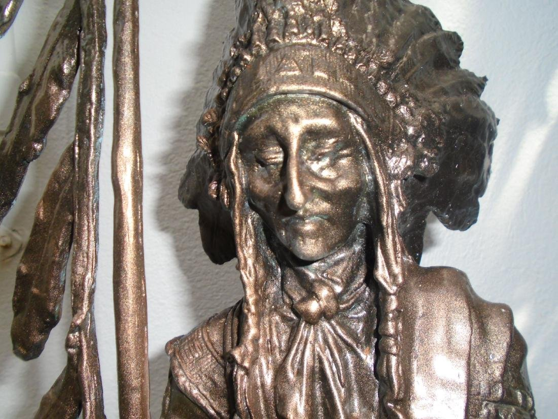 Indian chief standing holding a peace pipe & feathered - 3
