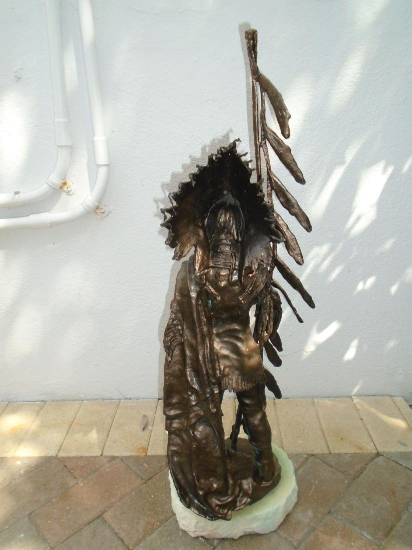 Indian chief standing holding a peace pipe & feathered - 6