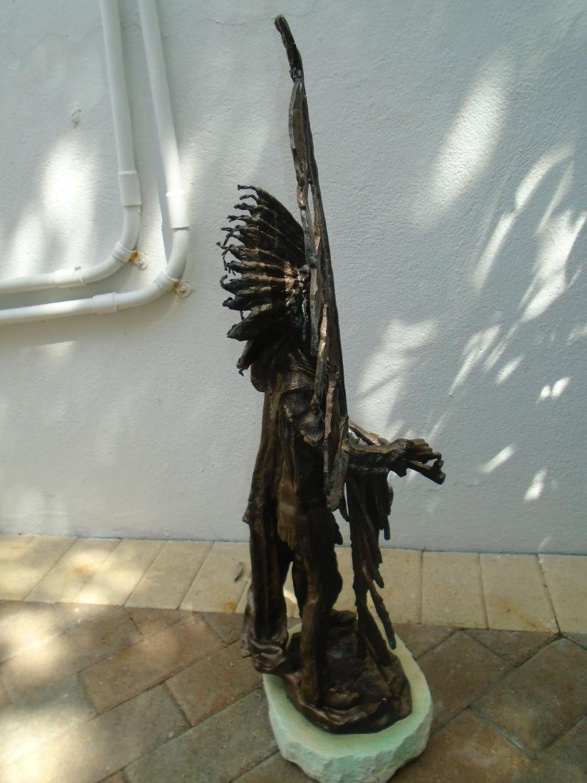 Indian chief standing holding a peace pipe & feathered - 7