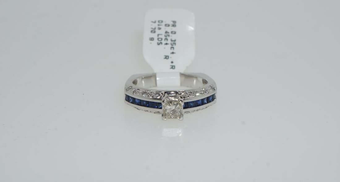 Ladies Princess Cut Diamond and Saphire Baguette Ring
