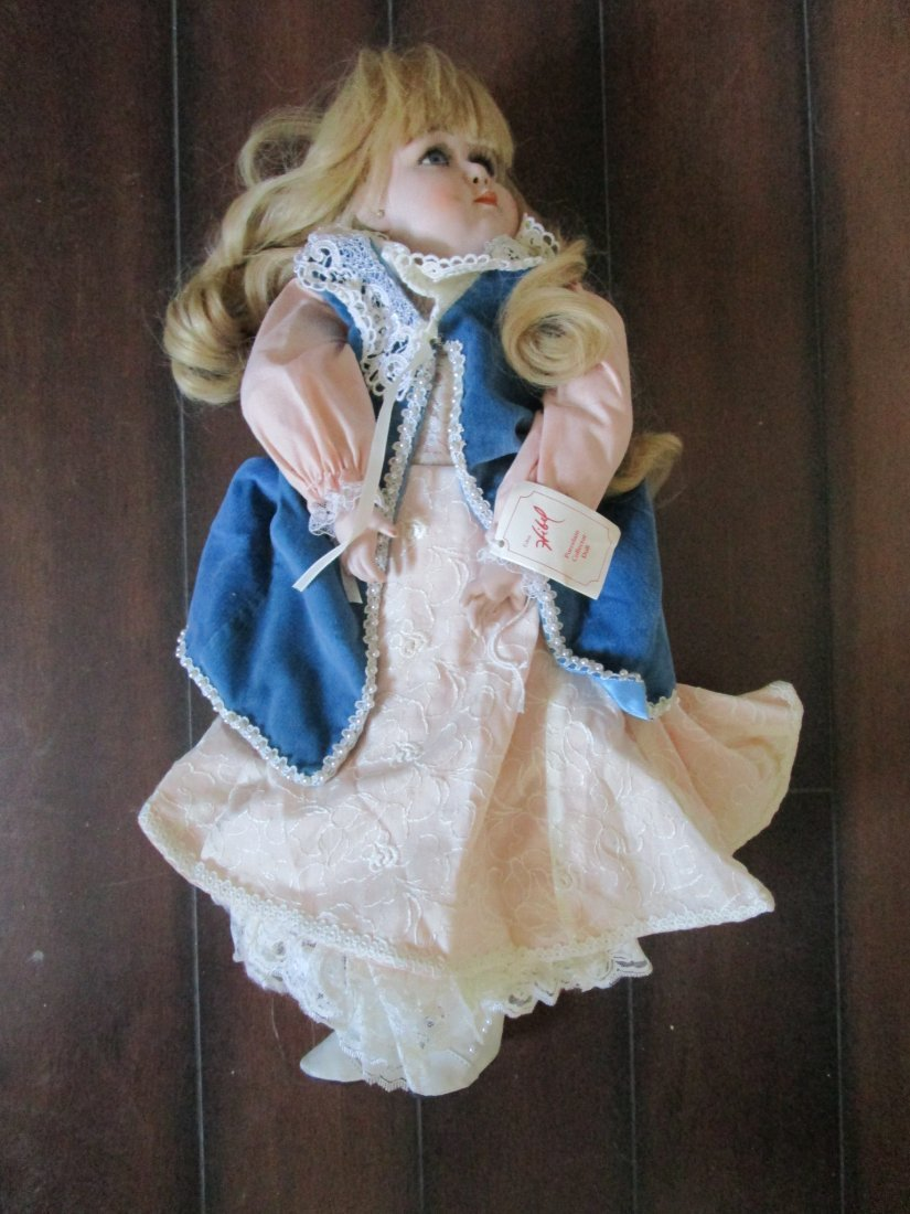 Large rare Porcelain Doll by Edna Hibel - value 200.00