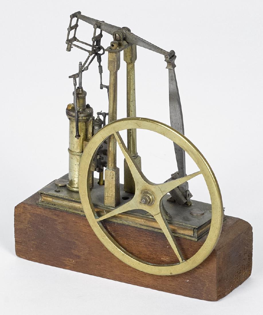 Small brass walking beam engine model, mid 19th c.,
