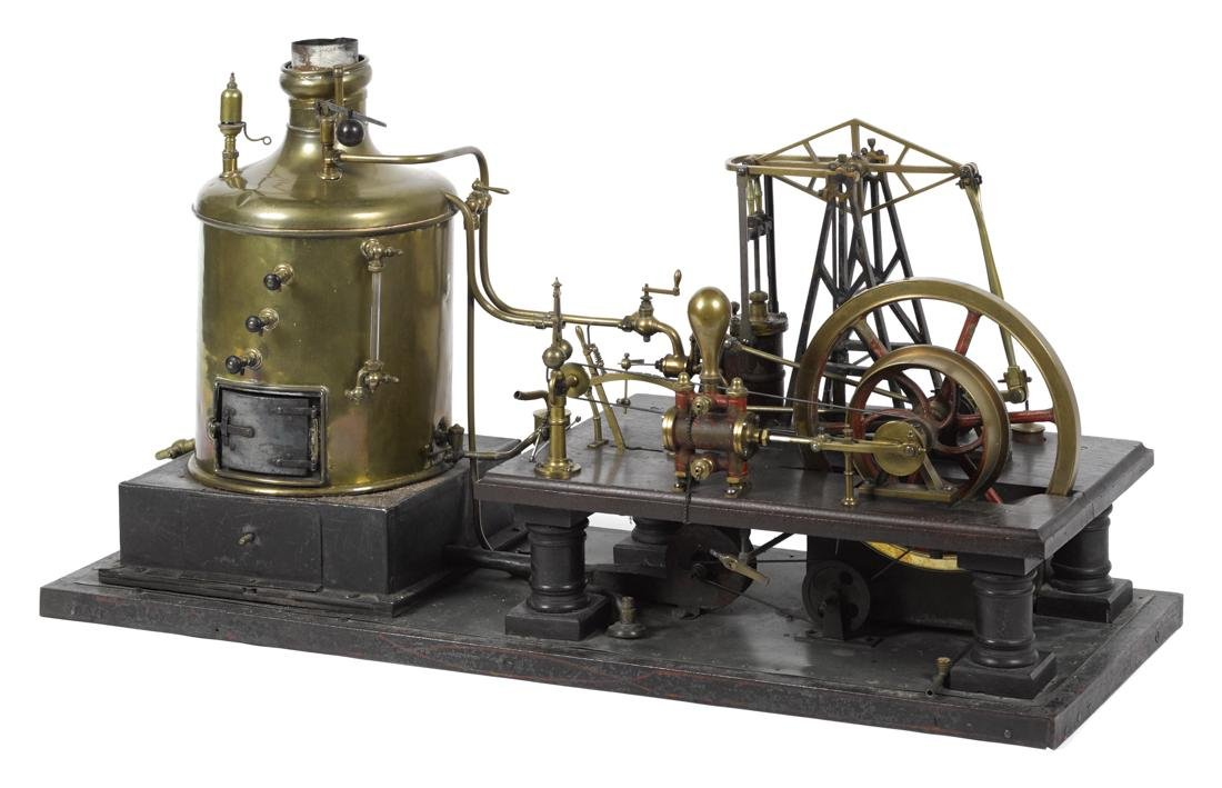 Large brass and copper walking beam steam engine with a