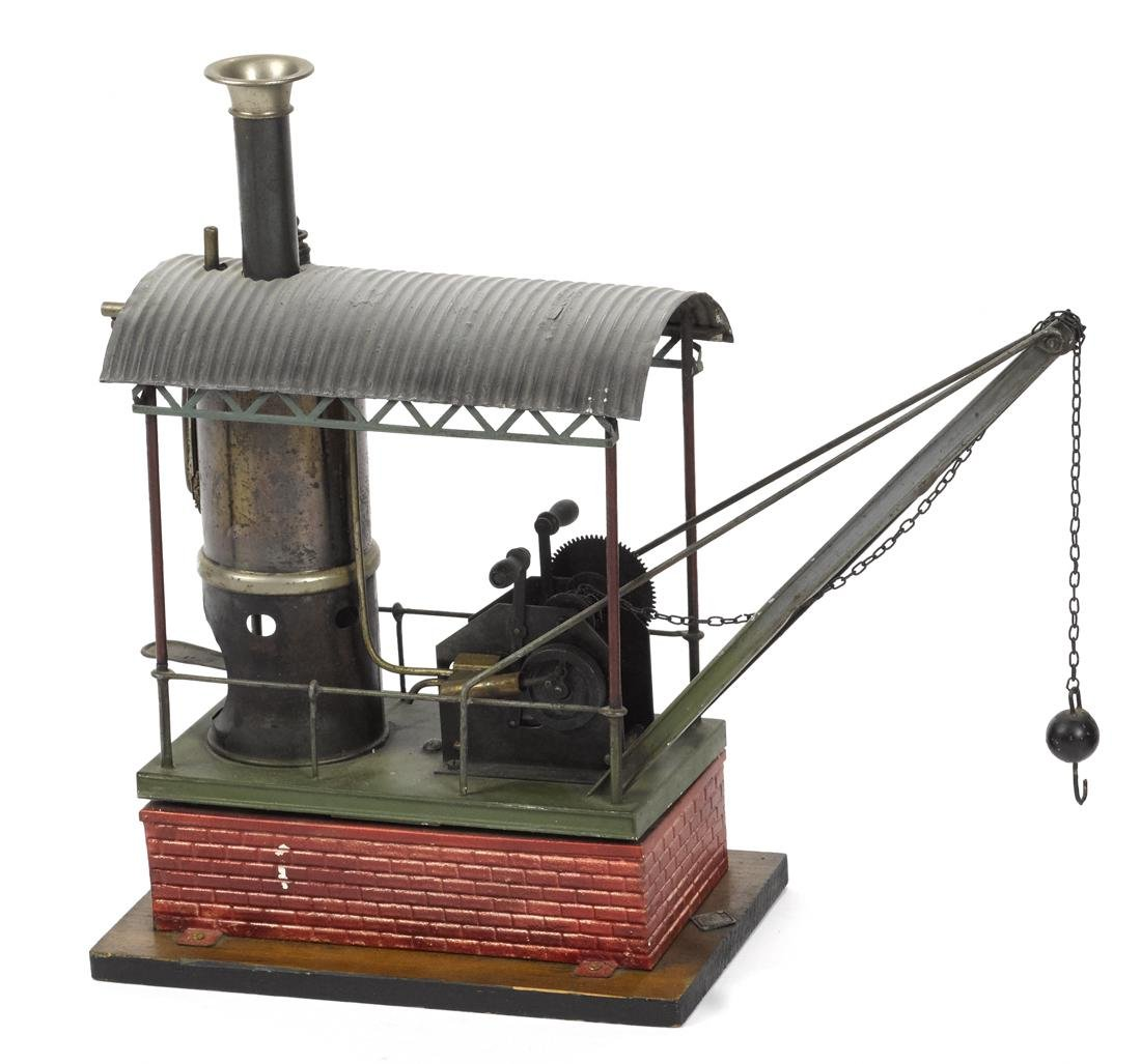 Bing live steam crane, with a faux brick and wood base