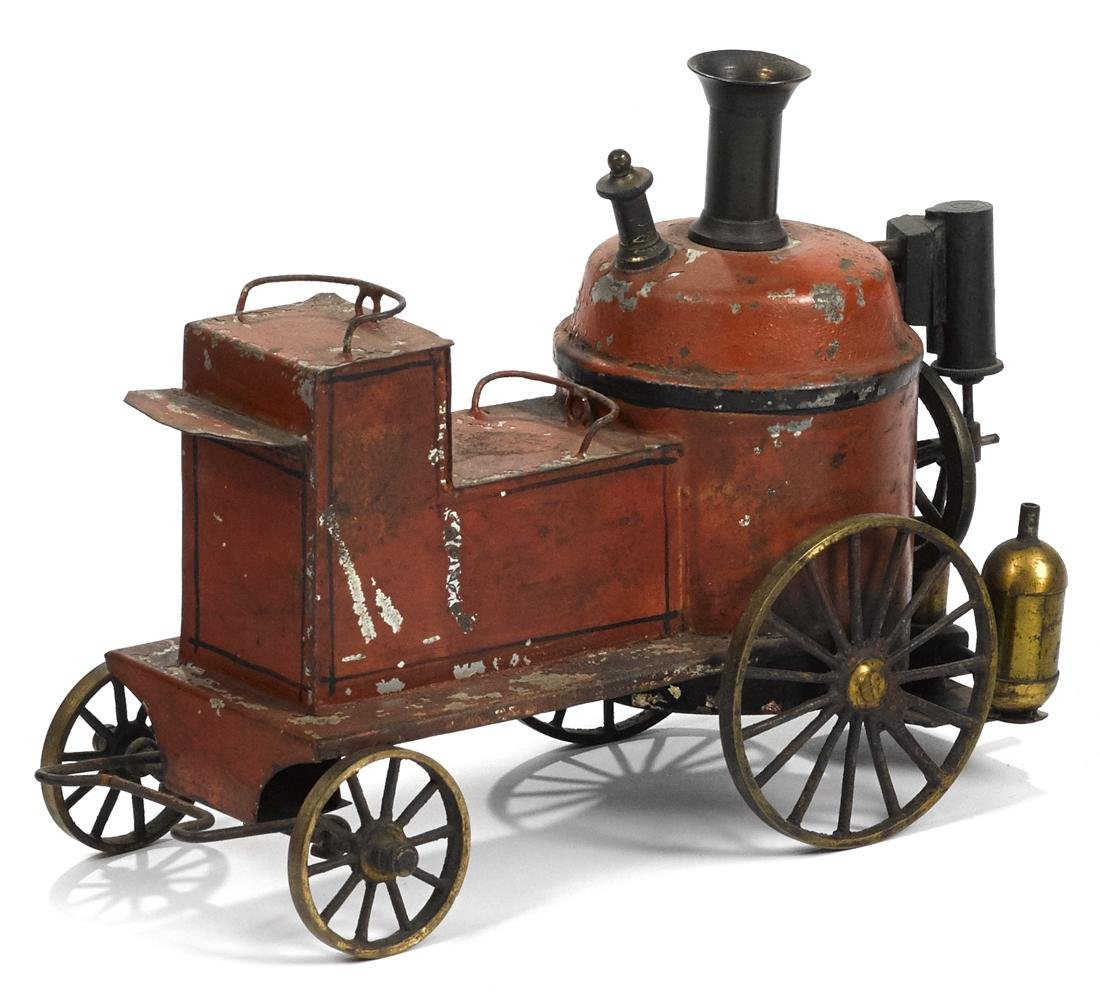 Painted tin live steam fire pumper with brass wheels
