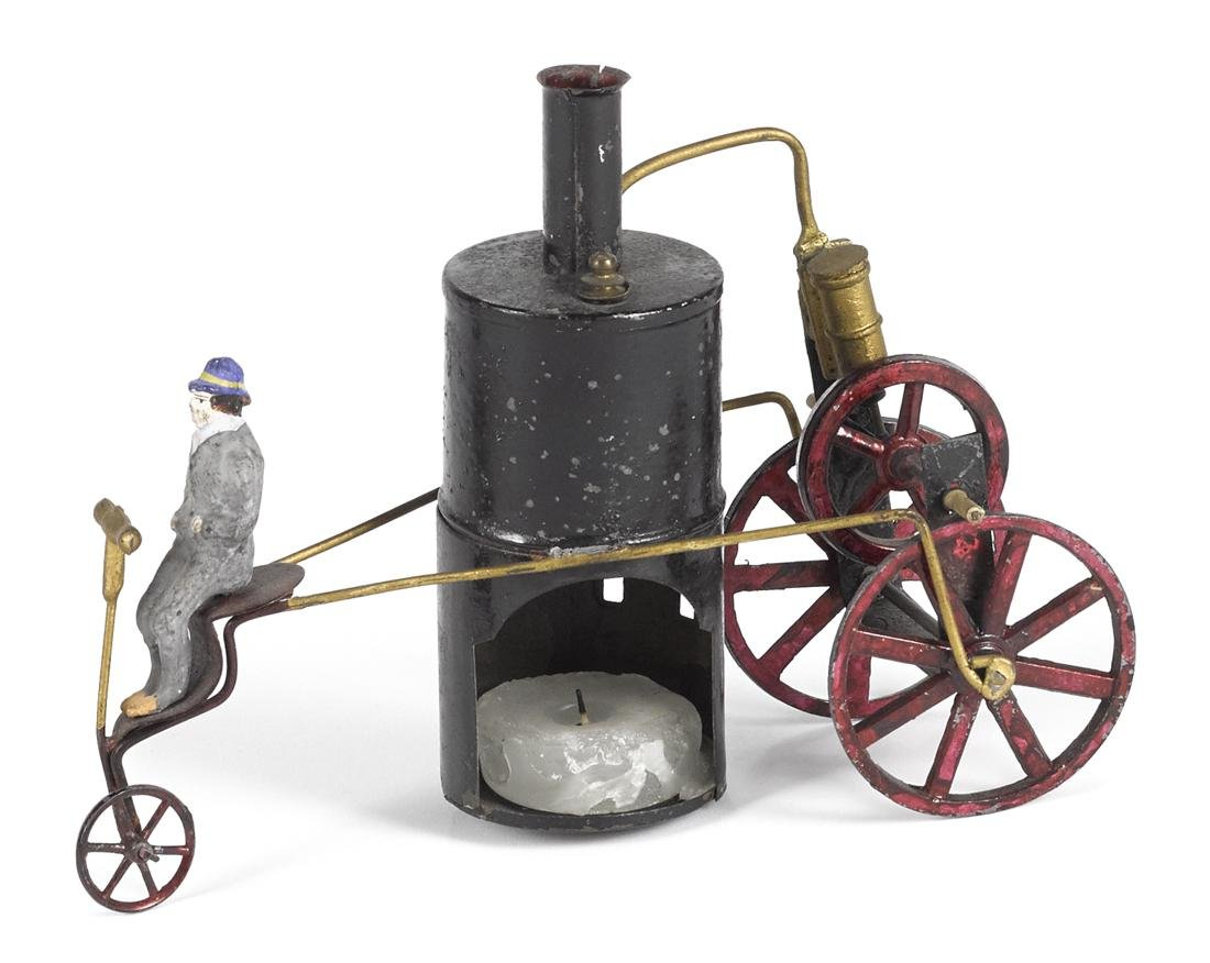 Schoenner steam powered tricycle with tin stained cast