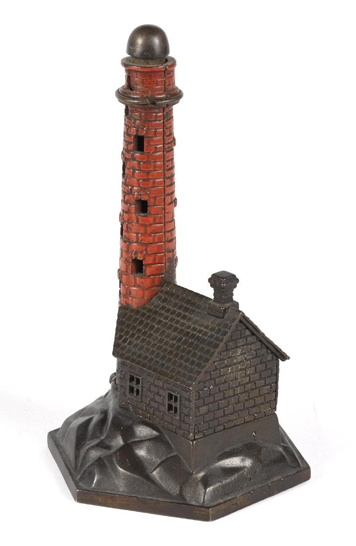 Cast iron Lighthouse mechanical bank.