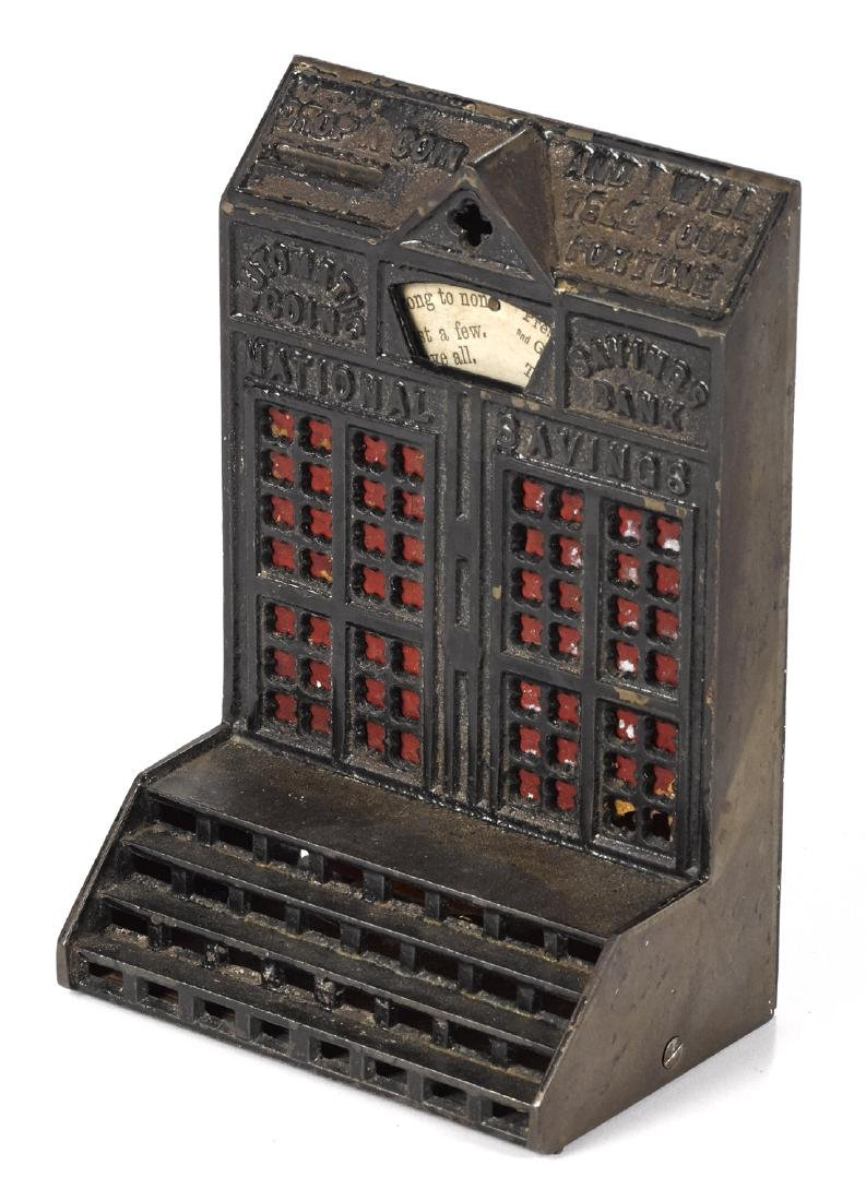 Cast iron Automatic Coin Savings mechanical bank.