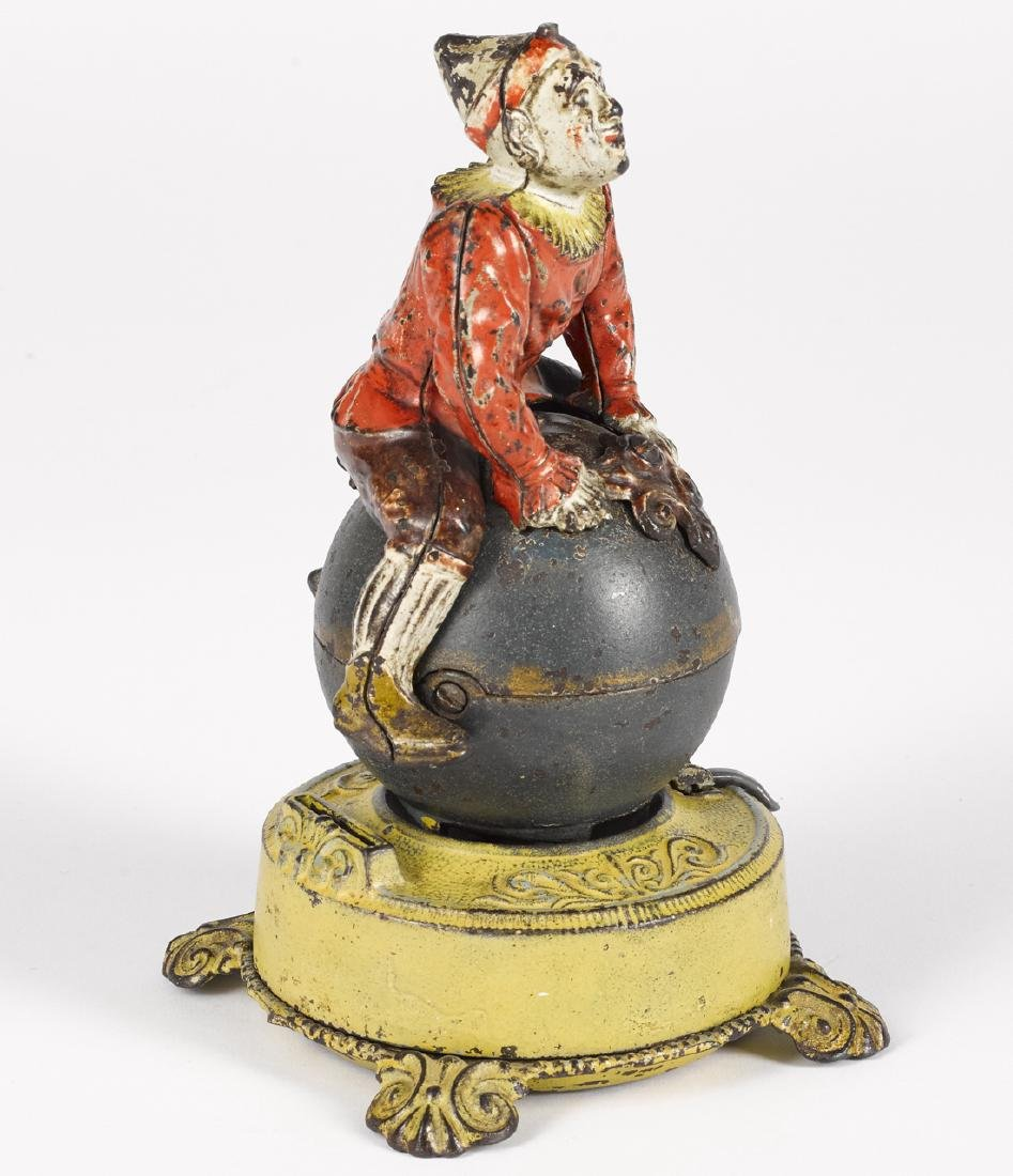 J. & E. Stevens cast iron Clown on Globe mechanical