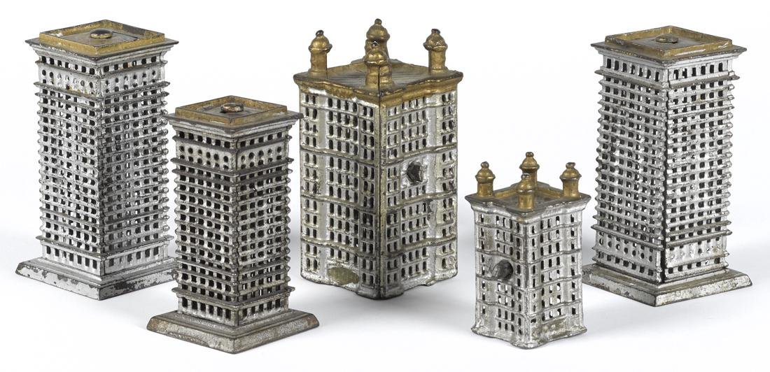 Five cast iron building still banks, to include three